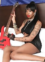 Looking sexy as hell stripping out of her outfit, black tgirl Holly Strokes poses with the bass guitar. Then, she jacks it until she cums!