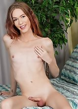Redhead beauty Crystal Thayer is stunning! Watch her stroking her cock until she cums!