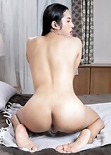 Ladyboy Nam has a sexy body and a perfect ass! Watch her posing, fucking her tight hole with a dildo and stroking her cock until she cums!