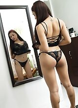 Hot Exotic shemale VITRESS TAMAYO in black lingerie stripping at home